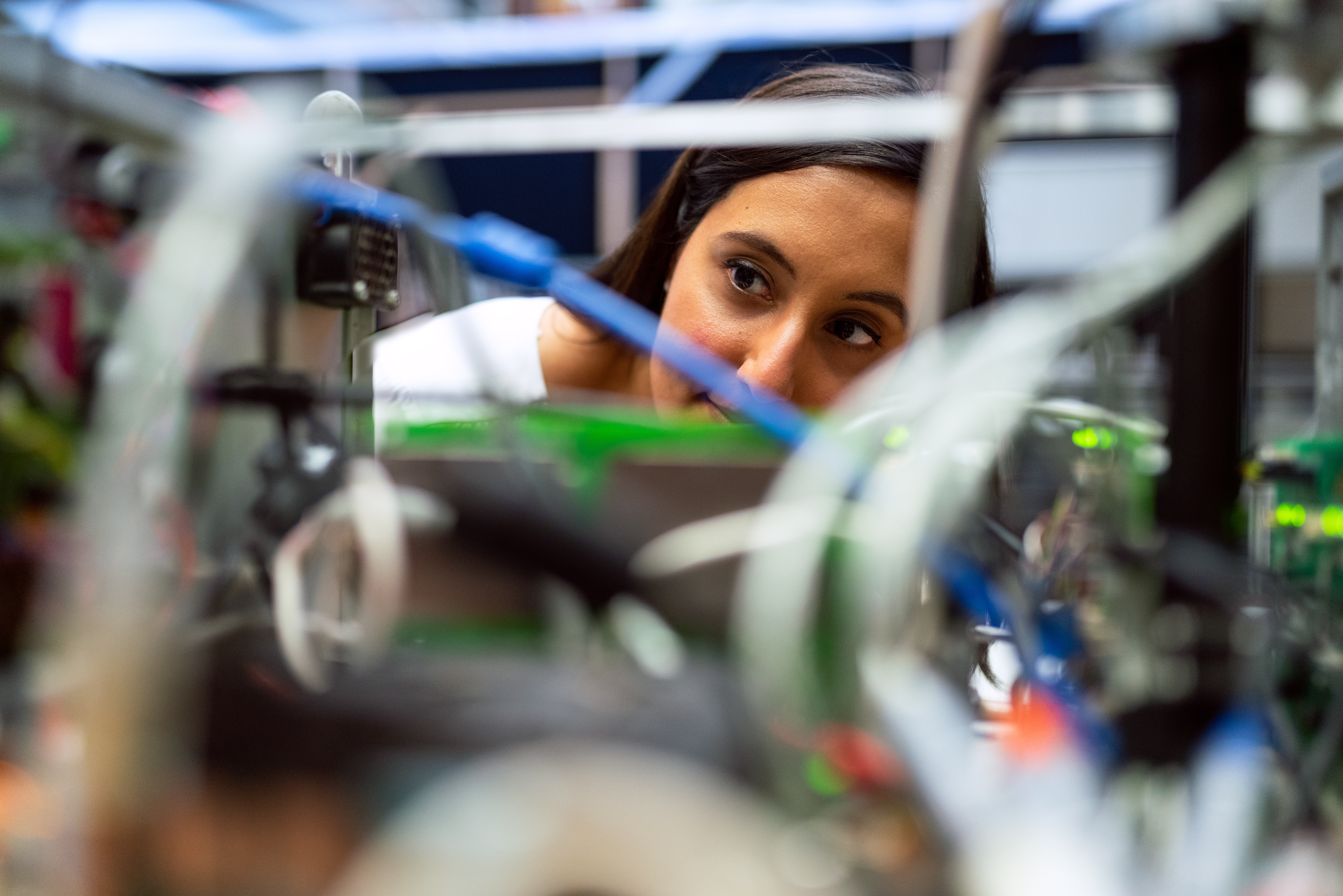female computer science student looking at computer
